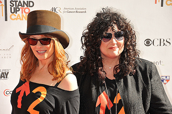 (L-R) Guitarist Nancy Wilson and singer Ann Wilson of Heart/Getty Images
